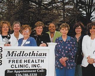 "Maureen Cronin, executive director of the Midlothian Free Health Clinic in Youngstown, submitted this photo of ""Dr. Albani's Angels."" Under the supervision of Dr. Thomas Albani and other physicians, these women ""work endless hours providing quality health care to the uninsured of the Youngstown area,"" she writes. The doctors and nurses volunteer their time. Pictured are, from left, head nurse Carol Beard, Jerri Smith, Kathleen Berry, Jean Slenker, Annette Carnie, Robin McCaulley, Sandra Reel, Amy Stanovcak, Anna Lynch and Virginia Petefish. All are RNs, except for Robin, a student LPN. Missing are Bridget Romeo, CNP; Majorie Betts, Marlene Carney, Debbie Hromyak, CNP; Tila Miller, Becky Tareshawty, Nellie Tucker, Carol Dumas and Jenna Cicchillo, CNP. All not identified as a CNP are RNs."