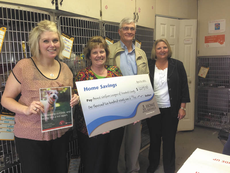 SPECIAL TO THE VINDICATOR Home Savings offices in Trumbull County recently hosted bake sales and presented $1,279.70 to Animal Welfare League of Trumbull County. From left to right are Desirae Monaco, Home Savings Howland office; Kim Gennaro, Home Savings Liberty office; Dr. Jeff Williams, president of Animal Welfare League; and Colleen Miller of Home Savings McDonald. The Animal Welfare League works to reduce suffering and improve the lives of animals.