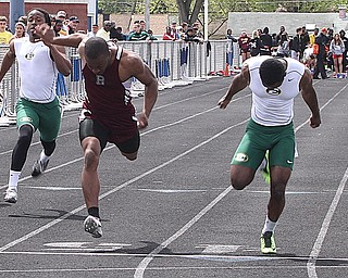 NICK MAYS l THE VINDICATOR  Nathan Jones of Boardman and Shaun Crawford of St. Edwards reach for the finish in the 100 meter dash Saturday afternoon in Austintown. 05042013 austintown, ohio