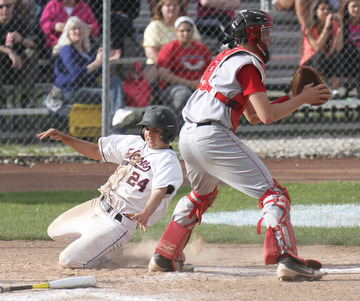 William d Lewis the vindicator Fitch's Shane Vitullo(24) scores as Niles catcher Ian Hileman(4) waits for the throw. Fitch won 1-0.