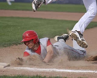 William d Lewis the vindicator Niles Cameron Carson15) gets back to first ahead of the throw as Fitch Firstbaseman Phil Socha(14) tries for the catch.