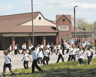 Children and their teachers gather outside the Mill Creek Children's Center preschool on Essex Street on Youngstown's South Side after evacuating the building Monday afternoon due to a bomb threat written on a girls' restroom wall in the adjoining Youngstown Community School. Police searched the buildings and found no bomb, and the children and staff re-entered the buildings after 30 minutes outside.