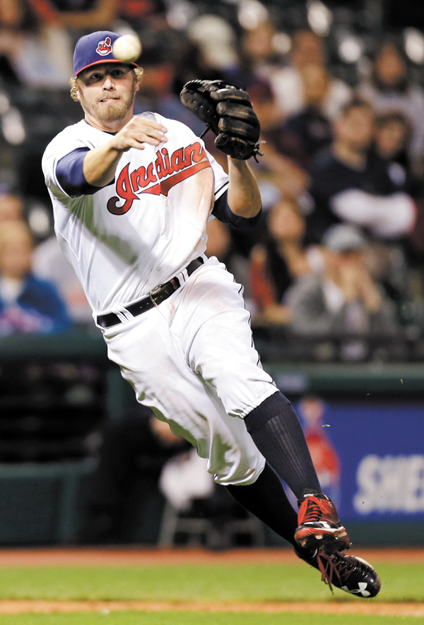 Cleveland Indians third baseman Mark Reynolds throws out the Oakland Athletics' Luke Montz in the ninth inning of a game Monday in Cleveland.