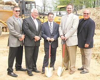 From left, Jim Pastore, Carl Frakovitch, Tim Huber, Joe Cilone, and Larry Petrozzi share in the groundbreaking