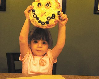 Sophia Testa shows off her work of art.