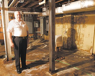Boardman Township Fire Chief George Brown stands in the basement of the main fire station on U.S. Route 224 near Southern Boulevard. The basement is riddled with mildew, sump pumps and dehumidifiers. The township is trying to devise a plan to renovate the station or build a new one. Lack of money is the main obstacle.