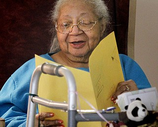 MADELYN P. HASTINGS | THE VINDICATOR  Danridge Nursing Home resident, Olive Dixon, smiles as she reads a Mother's Day card given to her by students involved in the after school program at Martin Luther King Elementary.