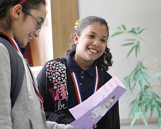 MADELYN P. HASTINGS | THE VINDICATOR   (L-R) Fifth graders Kimberly Nieves and Jailenette Morales read a Mother's Day card to residents at Danridge Nursing Home. The kids involved with the after school program at Martin Luther King Elementary presented the ladies of Danride Mother's Day cards, songs and poems.