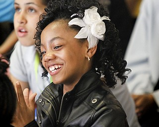 MADELYN P. HASTINGS | THE VINDICATOR  Fourth grader Laniya Lewis applauds during the performance given Martin Luther King Elementary after school program students at Danridge Nursing Home.