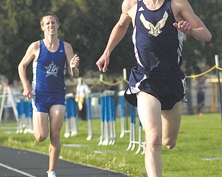 Patrick Kunkel, a senior from McDonald High School, leads the second heat of the boys 1,600-meter run during the Trumbull County Track and Field Meet on Thursday at Lakeview High School in Cortland. Kunkel took first place and also was named running MVP. Team honors went to Lakeview boys and McDonald girls.