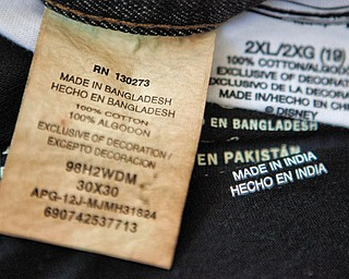 This illustration shows labels of garments made in Bangladesh, India, China and Pakistan that were bought at a Walmart store in Atlanta. Global clothing brands involved in Bangladesh's troubled garment industry responded in starkly different ways to the building collapse that killed at least 1,100 people. Some quickly acknowledged their links to the tragedy and promised compensation. Others denied they authorized work at factories in the building even when their labels were found in the rubble.