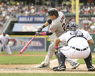 Cleveland Indians' Jason Kipnis (22) hits a two-run double off Detroit Tigers starting pitcher Rick Porcello during the third inning of a game in Detroit on Sunday.