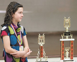 Jackie Grisdale listens to a presentation about her wins as grand  champion of the 2013 National Handwriting Competition. The fourth-grader was honored by language-arts company Zaner-Bloser as the grade-level state, national and grand national champion of its annual contest.