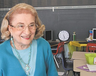 Rae Jeanne Mollica visits her old classroom at Watson Elementary in Austintown during a Monday open house at the school. She started teaching there in 1963 and is now a tutor at the school, which is set to close as new buildings are constructed.