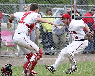 William d Lewis the Vindicator  Niles catcher Ryan Ifft(4) and pitch Tyler Wiery(6) celebrate after defeating Canfield 1-0 during a Tuesday game at Niles.