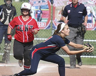 William D. Lewis\The Vindicator Kent's xxxxxxx(11) is out at first as Fitch 1rst baseman Gabby Butcher(11) makes the catch during 5/15 game at Fitch. The Falcons won 4-2..