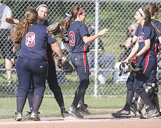 William D. Lewis\The Vindicator.Celebrating after a 4-2 win over Kent Wed 5/15/13 at home are Fitch's l-r Alex Franken(8), Gabby Butcher(11), Cali Mikovich(3) and Nicholette Zordich(4).