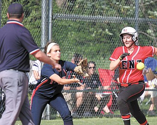 Kent's Mary Gavriloff (15) heads to first base, but is out as Fitch first baseman Gabby Butcher(11) makes the catch during their Division I tournament softball game Wednesday at Fitch High School in Austintown. Trailing 1-2 until the sixth inning, Butcher, a junior, connected for a two-out RBI double to put the Falcons ahead, 3-2. A single by Mercedes Pratt scored Butcher and gave Fitch the 4-2 win. The Falcons' next game is set for Tuesday at The Fields of Dreams in Boardman.