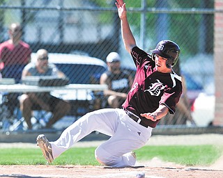Boardman's Nico DiIanni slides into home to score the Spartans' first run of their Division I sectional final against Warren Harding on Thursday in Warren. The Spartans ousted the Raiders, 20-3.