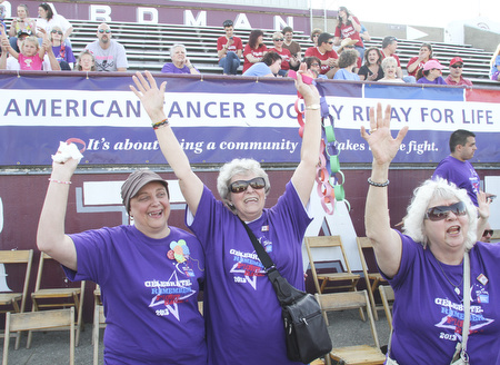 William D. Lewis The Vindicator Cheering during Boardman Relay For Life Friday May17,2013 are cancer survivors from left, Pam Hart of Girard, Kathyrn Senedak of North Jackson and Anita Hart of Girard.