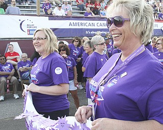 William d Lewis The Vindicator  Cancer survivors Melissa Cherne, left, and Carol McGraw, both of Boardman, lead the survivors lap of hte Boardm Relay for Life Friday. McGraw, a 17 year survivor, was a speaker at the event.