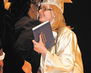 Nicole Miller smiles after receiving her high school diploma during Youngstown Early College commencement.
