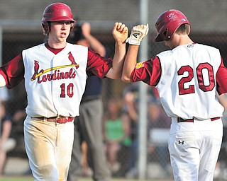 Cardinal Mooney's Drew Beck (10) is congratulated by Ryan Megyesi (20) after scoring a run in the top of the second inning against Struthers on Tuesday.