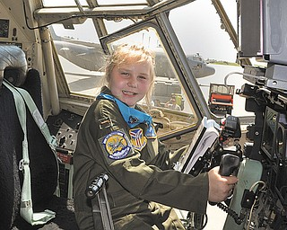 Kylee Vidas of Howland sits in the cockpit of one of the 910th Airlift Wing's C-130 Hercules military transport aircraft at the Youngstown Air Reserve Station in Vienna. Kylee, who has Type I diabetes, was sworn in Wednesday as an honorary Air Force Reserve second lieutenant and made Pilot for a Day at the 910th.