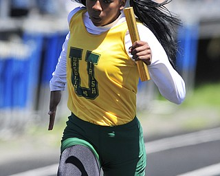 Ursuline runner Alexandra Carnathan sprints to the finish line to finish fist during the girls 4x100 meter relay.