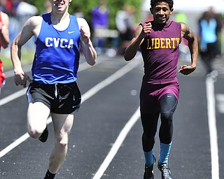 Liberty runner John Helms attempts to close the gap between him and CVCA runner Sherman Kortze during the final stretch of the boys 400 meter dash.