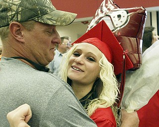 William D. Lewis\The Vindicator Girard HS grad Kara link gets a hug from her dad John Klink after Suday commencement ceremony at GHS..
