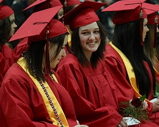 IMG 9252: ÊValedictorian Sabrina Leonard (right) smiles at classmate Allison Guerrieri (left)Êduring commencement at the Struthers Field House on Sunday. ÊDustin Livesay Ê| ÊThe Vindicator Ê5/26/13 ÊStruthers High School. Ê