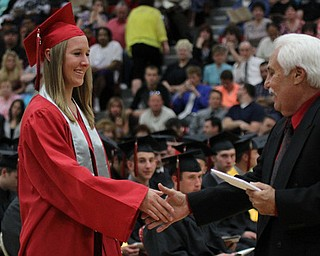 .IMG 9268: ÊAshley Hefferon (left) shakes hands with Board of Education president Ron Carcelli before receiving her diplomaÊduring commencement at the Struthers Field House on Sunday. ÊDustin Livesay Ê| ÊThe Vindicator Ê5/26/13 ÊStruthers High School. Ê