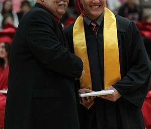 .IMG 9307: ÊAnthony Lariccia poses for a picture withÊBoard of Education president Ron CarcelliÊduring commencement at the Struthers Field House on Sunday. ÊDustin Livesay Ê| ÊThe Vindicator Ê5/26/13 ÊStruthers High School. Ê