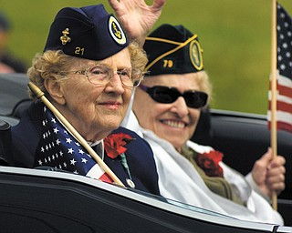 Nan Reeveley, front, and Florence Pearl, both of Boardman, ride in the North Coast WAVES Unit 21 car, waving to spectators during the Memorial Day Parade in Boardman.