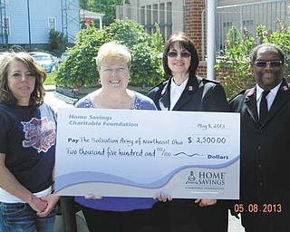 SPECIAL TO THE VINDICATOR Home Savings Charitable Foundation has donated $2,500 to the Salvation Army of Northeast Ohio to support the emergency food program in East Liverpool. From left are Megan Bennett, office administrator/case manager, Salvation Army; Judy Smit, senior branch manager, Home Savings; and Majs. Stella McGuire and Douglas McGuire, pastors, Salvation Army. Federal funds and private donors support the emergency food program. For  information on the Salvation Army of Northeast Ohio call 216-861-8185 or visit www.use.salvationarmy.org.