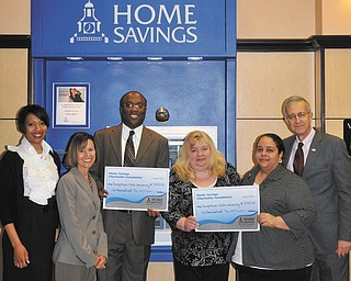 SPECIAL TO THE VINDICATOR Home Savings Charitable Foundation donated $10,000 to two programs at Youngstown State University. The Summer Bridge Program, a multicultural student retention program, and Beeghly College of Education Boot Camp, a learning community for students of color  designed to retain students in the program, each received $5,000. From left are Jacquelyn Johnson, YSU development officer; Jonelle Beatrice, interim executive director, Student Life at YSU; Michael Beverly, senior coordinator II, Center for Student Progress, YSU; Jeanne Watson-Antol, retail manager, YSU Home Savings; Crystal Hawthorne, coordinator of teacher certification/licensure, YSU; and Charles Howell, Dean of the college of education, YSU. For information about YSU call 330-941-3000 or visit www.ysu.edu.