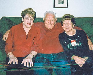"""Betsy Koneval of Youngstown, left, sent in this photo she calls """"Grandparents Hug,"""" taken of herself, her husband, John, and Mary Fonner of Youngstown. Betsy says, """"Whenever our family and friends get together, there is always a lot of 'huggin' going on."""""""