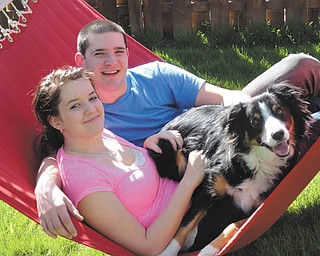 Joyce Howard of North Jackson sent in this photo of Benjamin A. Howard Jr. of Boardman and Heather Atkinson of East Palestine, who have been dating since July 2010. This photo, which includes Ben's Border Collie, Luke, was taken right before Ben left for the Navy.