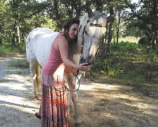 Amity McFarlin of Paradise, Texas, granddaughter of recently deceased Youngstown resident Dorothy Clark, hugs Rascal. Photo sent in by Sherry Parent of Youngstown.