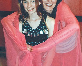 Karen Shneider and Renee Dashon pause at belly dance class at Judy Conti's Dance Studio. Photo sent in by Lana VanAuker of Canfield.