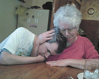 Annette Stanislaw hugs her son Alexis on Memorial Day in Lansingville. Photo sent in by Sherry Parent of Youngstown.