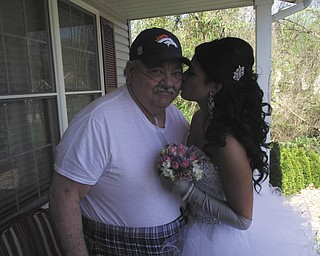 """Michelle Winebold submitted this photo of her father, Ronald Hrusovski, and her daughter, Taylor Winebold. Michelle writes, """"My dad is usually homebound due to his illness ... however, he made a special trip over to our house to see his granddaughter all dressed up for the Struthers High School Senior Prom on May 3."""""""