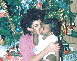 Othella May of Youngstown says it was Christmas 1986 when this picture was taken of cousins Michael and Tisha, who were 1 and 7 years old at the time. Both are of  Youngstown.