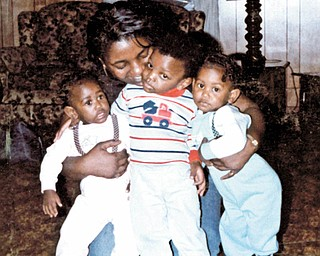 Carol and Marcus Thomas and twins Michelle an Michael Pete, all of Youngstown, share a group hug. Photo sent by Othella May of Youngstown.