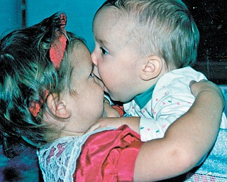 Ann Michelle Jesko, 3, gets a little more of a hug than she probably bargained for from Carolyn Leigh Jesko, 1. Photo sent in by Gramma Sophia Juruaz of Youngstown.