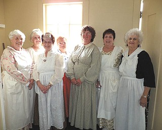 SPECIAL TO THE VINDICATOR Girard Historical Society members are preparing to serve the annual tea, which will take place at 2 p.m. June 29 at Barnhisel House, 1011 N. State St., Girard. From left are Shirley Hunter, Sally Curl, Colette Chuey, Pat Hill, Roberta Lawrentz, Mary Anne Creatore and Ellen Surak. Members not in the photo are Patty Finelli and Carlie O'Neill. The cost is $12 for adults and $6 for children 12 and under. The program is Victoria's Lady in Waiting. There will be a basket raffle, door prizes and a prize for the best hat. For information call 330-652-9838 or 330-307-3448.