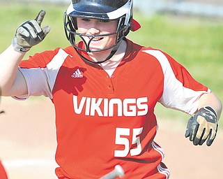 LaBrae's Jessica Buck (55) celebrates after scoring a run in a Division III regional semifinal on Thursday. Teammate Emily Dugan greets Buck. LaBrae defeated Ursuline, 10-2, and will meet Columbia Station at noon on Saturday.