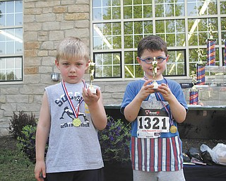 Vision for Veterans event features Toddler Trot The Toddler Trot, for kids age 4 and under, was part of the Vision for Veterans 5K race that took place May 17 in Columbiana. The top three are, from left, above, Dylan Stoffer, 4, who finished second with a time of 24.60 seconds for the 100-yard measurement; and Shane Bacon, 4, whose time was 22.10 seconds; and below, Connor McNinch, 4, in third place, whose time was 25.30 seconds.