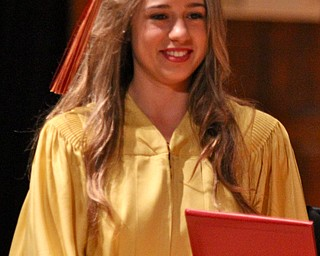 Shannon Saadey looks down at her diploma during the Cardinal Mooney commencement at Stambaugh Auditorium in Youngstown on Sunday.  Dustin Livesay  6/2/13  Youngstown.